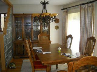 Photo 5: 7848 BURRIS Street in Burnaby: Burnaby Lake House for sale (Burnaby South)  : MLS®# V893651