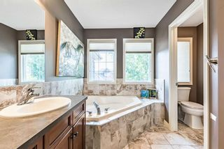 Photo 27: 157 Springbluff Boulevard SW in Calgary: Springbank Hill Detached for sale : MLS®# A1129724
