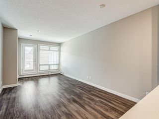 Photo 7: 216 823 5 Avenue NW in Calgary: Sunnyside Apartment for sale : MLS®# A1127836