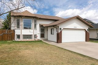Photo 1: 1138 Maple Avenue: Crossfield Detached for sale : MLS®# A1101618