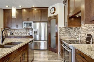 Photo 5: 83 ASPEN STONE Manor SW in Calgary: Aspen Woods Detached for sale : MLS®# C4259522