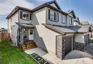 Photo 1: 2360 BAYWATER Crescent SW: Airdrie Semi Detached for sale : MLS®# A1025876