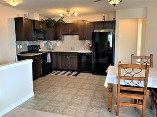 Photo 7: 1503 250 Sage Valley Road NW in Calgary: Sage Hill Row/Townhouse for sale : MLS®# A1079700