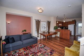 Photo 2: 211 Ranch Ridge Meadow: Strathmore Row/Townhouse for sale : MLS®# A1108236