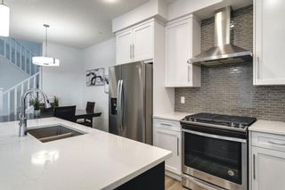 Photo 13: 618 148 Avenue NW in Calgary: Livingston Detached for sale : MLS®# A1149681