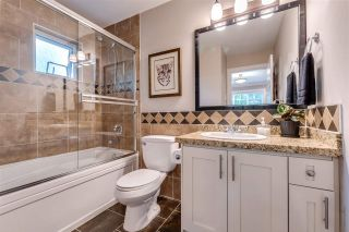 """Photo 14: 119 3333 DEWDNEY TRUNK Road in Port Moody: Port Moody Centre Townhouse for sale in """"CENTRE POINT"""" : MLS®# R2408387"""