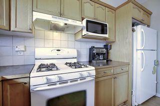 Photo 11: 408 128 CENTRE Avenue: Cochrane Apartment for sale : MLS®# C4295845