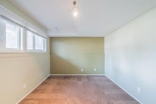 Photo 16: 117 Storybook Terrace NW in Calgary: Ranchlands Row/Townhouse for sale : MLS®# A1127202