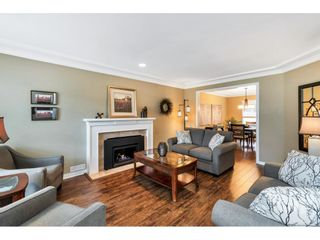 """Photo 5: 118 6109 W BOUNDARY Drive in Surrey: Panorama Ridge Townhouse for sale in """"LAKEWOOD GARDENS"""" : MLS®# R2625696"""