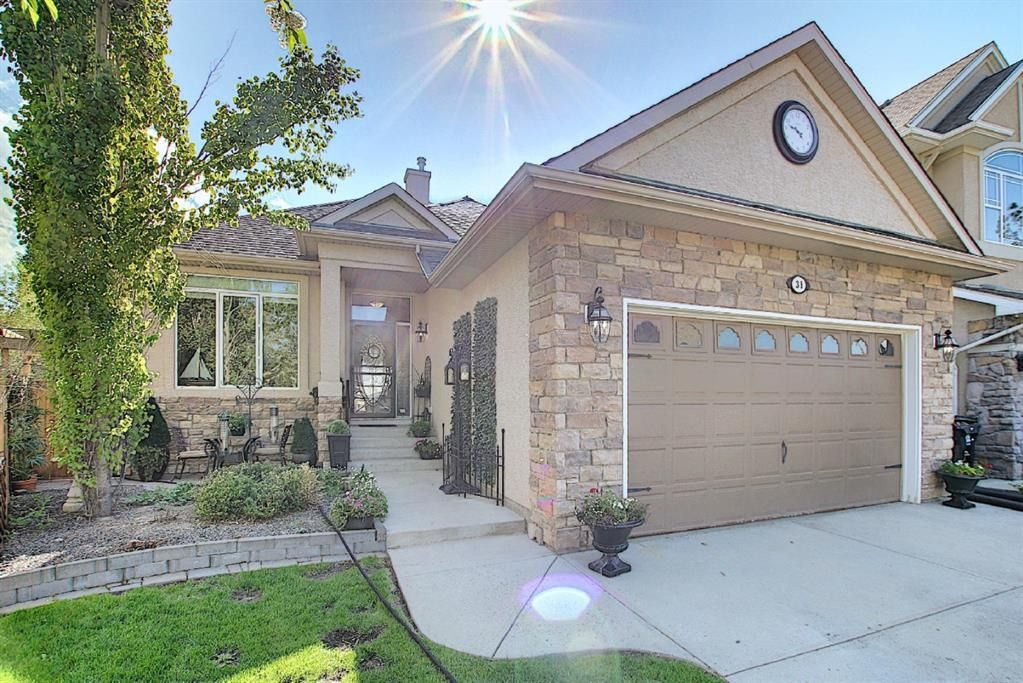 Main Photo: 31 Strathlea Common SW in Calgary: Strathcona Park Detached for sale : MLS®# A1147556