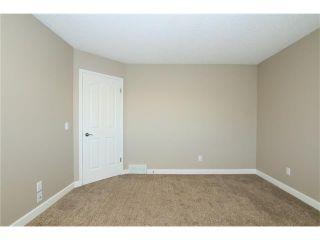 Photo 26: 74 WEST TERRACE Road: Cochrane House for sale : MLS®# C4073559