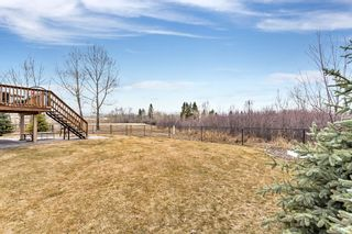 Photo 25: 52 Heritage Lake Mews: Heritage Pointe Detached for sale : MLS®# A1056186