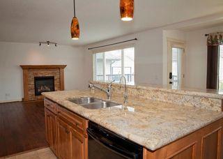 Photo 12: 232 CIMARRON Drive: Okotoks House for sale : MLS®# C4116292