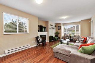 """Photo 2: 205 14960 102A Avenue in Surrey: Guildford Condo for sale in """"MAX"""" (North Surrey)  : MLS®# R2582382"""