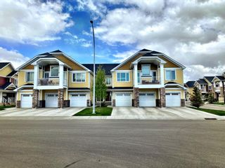 Photo 3: 403 2400 Ravenswood View SE: Airdrie Row/Townhouse for sale : MLS®# A1111114