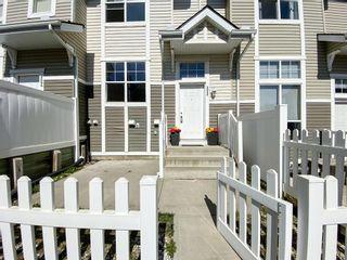 Photo 3: 3096 New Brighton Gardens SE in Calgary: New Brighton Row/Townhouse for sale : MLS®# A1097763