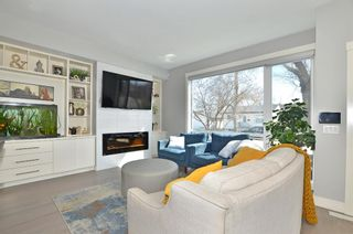 Photo 3: 154 21 Avenue NW in Calgary: Tuxedo Park Row/Townhouse for sale : MLS®# A1098746