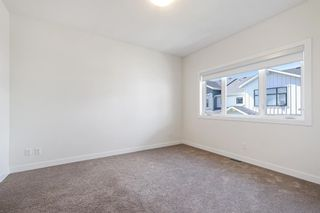 Photo 24: 12562 Crestmont Boulevard SW in Calgary: Crestmont Row/Townhouse for sale : MLS®# A1117892