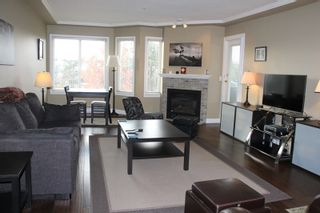Photo 2: 404 20453 53 AVENUE in Langley: Langley City Condo for sale : MLS®# R2120225