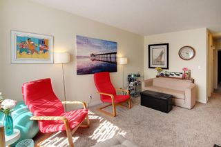 Photo 3: 7610-7612 25 Street SE in Calgary: Ogden Duplex for sale : MLS®# A1140747