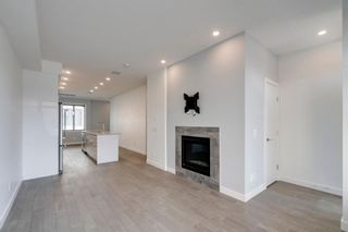 Photo 7: 104 1616 24th Ave NW in Calgary: Capitol Hill Row/Townhouse for sale : MLS®# A1104099