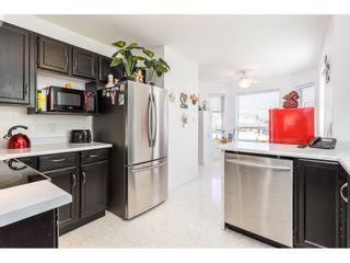 "Photo 6: 114 6841 138 Street in Surrey: East Newton Townhouse for sale in ""Hyland Creek Village"" : MLS®# R2546698"