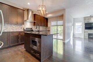 Photo 5: 40 Sunrise Terrace: Cochrane Detached for sale : MLS®# A1153580