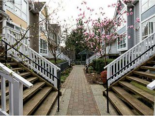 """Photo 1: 8 1015 LYNN VALLEY Road in North Vancouver: Lynn Valley Townhouse for sale in """"River Rock"""" : MLS®# V1007505"""