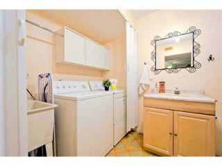 """Photo 20: 125 2721 ATLIN Place in Coquitlam: Coquitlam East Townhouse for sale in """"THE TERRACES"""" : MLS®# V1057013"""