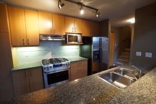 """Photo 1: 507 580 RAVEN WOODS Drive in North Vancouver: Roche Point Condo for sale in """"SEASONS"""" : MLS®# R2013840"""