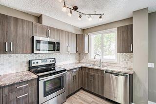 Photo 12: 25 2319 56 Street NE in Calgary: Pineridge Row/Townhouse for sale : MLS®# A1152342