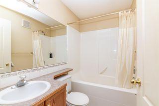Photo 10: 104 5220 50A Avenue: Sylvan Lake Row/Townhouse for sale : MLS®# A1146974