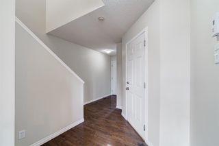 Photo 3: 4 136 Bow Ridge Drive: Cochrane Row/Townhouse for sale : MLS®# A1116097