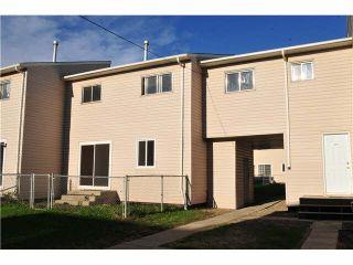 """Photo 1: 8838 101ST Avenue in FT ST JOHN: Fort St. John - City NE Townhouse for sale in """"GLENWOOD COMPLEX"""" (Fort St. John (Zone 60))  : MLS®# N245571"""