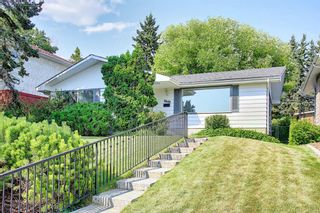 Main Photo: 3040 Conrad Drive NW in Calgary: Charleswood Detached for sale : MLS®# A1132754