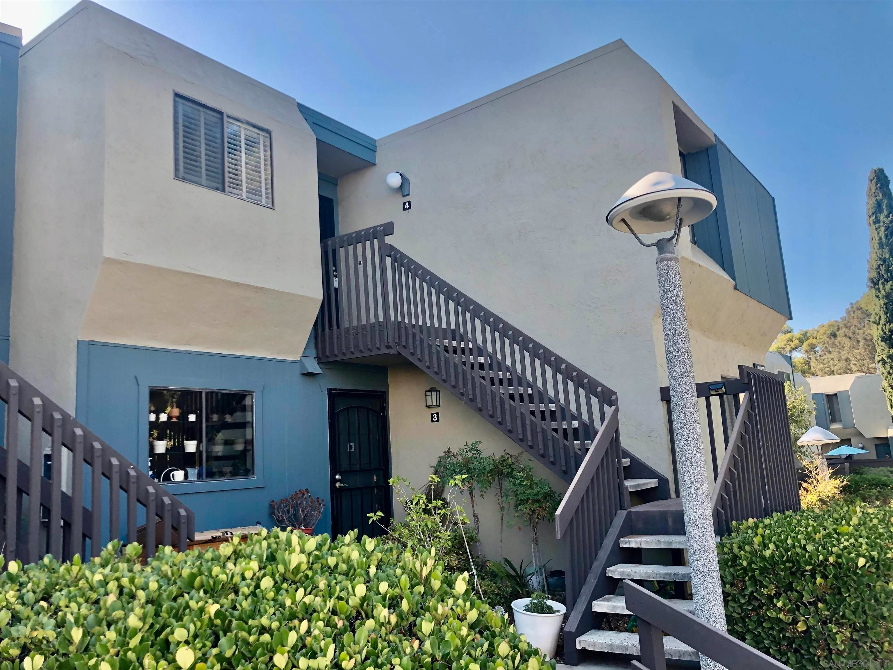 Main Photo: MISSION VALLEY Condo for sale : 2 bedrooms : 6379 Rancho Mission Rd #4 in San Diego