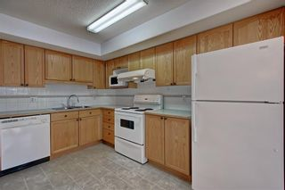 Photo 5: 6807 Pinecliff Grove NE in Calgary: Pineridge Row/Townhouse for sale : MLS®# A1121395