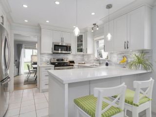 """Photo 1: 38 889 TOBRUCK Avenue in North Vancouver: Hamilton Townhouse for sale in """"TOBRUCK GARDENS"""" : MLS®# R2209623"""