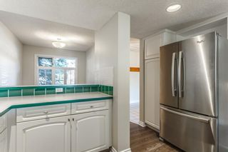 Photo 5: #34 5810 PATINA DR SW in Calgary: Patterson House for sale : MLS®# C4138541