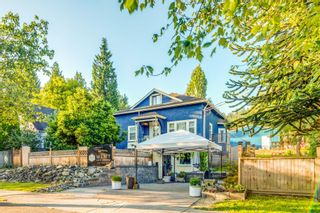 Photo 1: 2221 CLARKE Street in Port Moody: Port Moody Centre House for sale : MLS®# R2611613