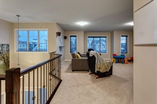 Photo 9: 144 Cougar Ridge Manor SW in Calgary: Cougar Ridge Detached for sale : MLS®# A1098625