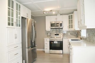 """Photo 11: 33358 4TH Avenue in Mission: Mission BC House for sale in """"Lane off Murray"""" : MLS®# R2252998"""