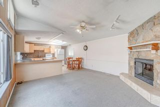 Photo 4: 214 Erin Woods Circle SE in Calgary: Erin Woods Detached for sale : MLS®# A1120105