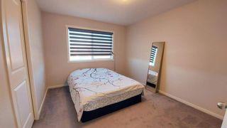 Photo 18: 110 Auburn Meadows Avenue SE in Calgary: Auburn Bay Semi Detached for sale : MLS®# A1095114