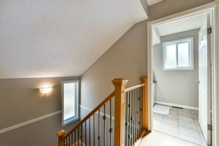 Photo 19: 1301 829 Coach Bluff Crescent in Calgary: Coach Hill Row/Townhouse for sale : MLS®# A1094909