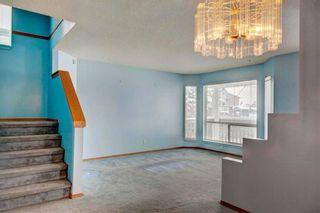 Photo 5: 254 SARATOGA Close NE in Calgary: Monterey Park House for sale : MLS®# C4165371