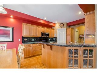Photo 8: 243 STRATHRIDGE Place SW in Calgary: Strathcona Park House for sale : MLS®# C4101454