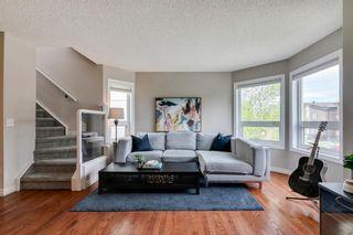 Photo 1: 1 123 23 Avenue NE in Calgary: Tuxedo Park Row/Townhouse for sale : MLS®# A1112386