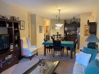 Photo 19: 302 77 GEORGE FOX Trail: Cochrane Apartment for sale : MLS®# A1070866