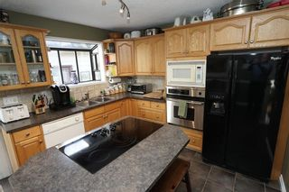 Photo 4: 64 STRATHCONA Close SW in Calgary: Strathcona Park House for sale : MLS®# C4142880